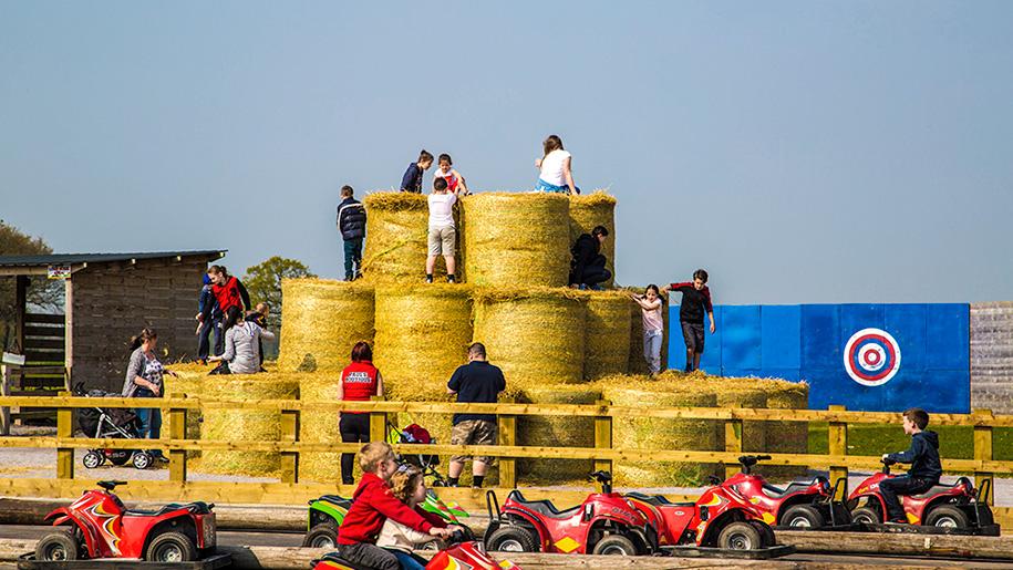 children climbing hay bails