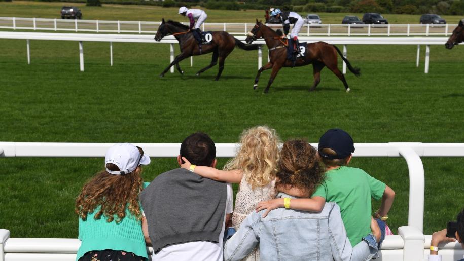 Family watching racing at Ascot