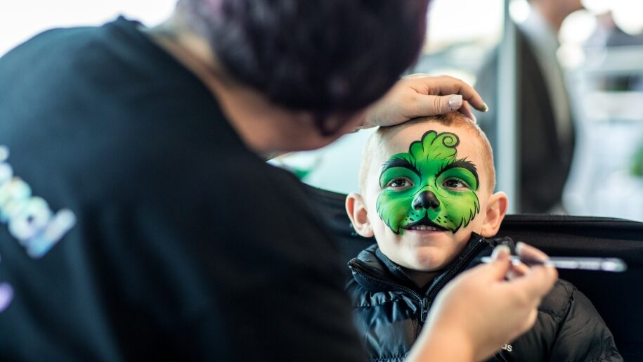 Child having face painted at Ascot