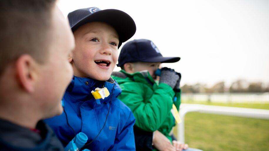 Boys enjoying watching racing at Ascot
