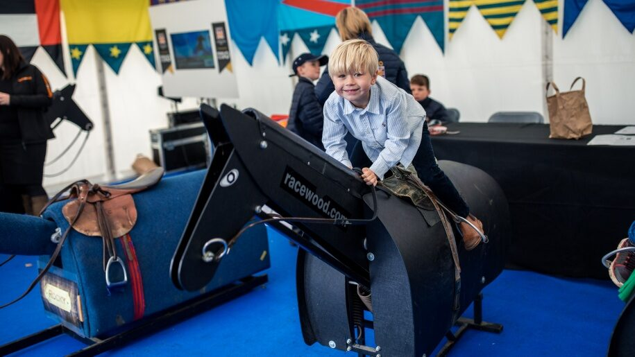 Young boy on mechanical horse at Ascot
