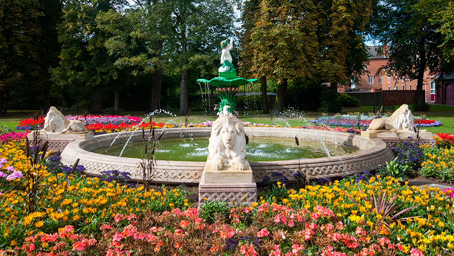 flowers by fountain