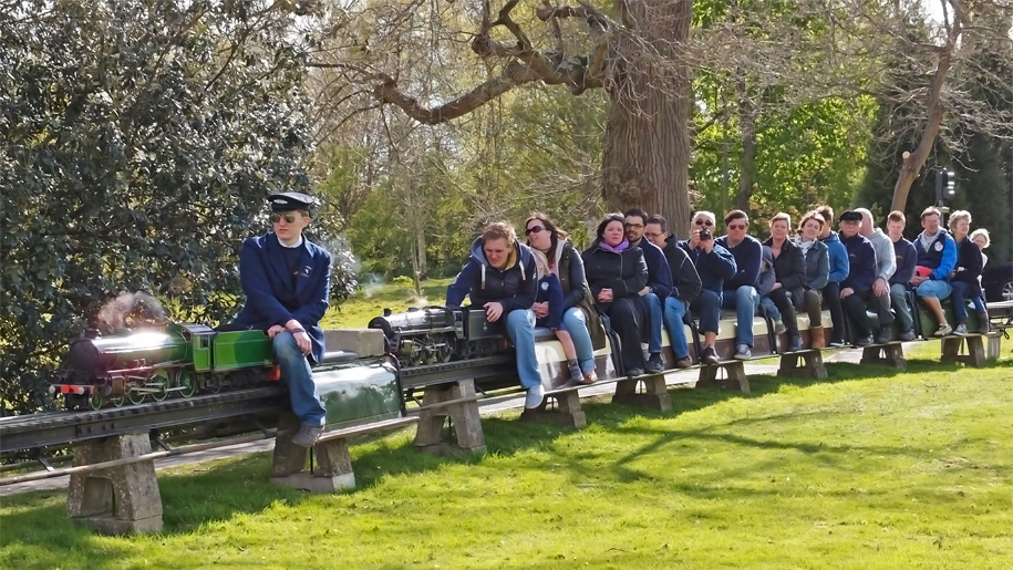 people riding the miniature railway