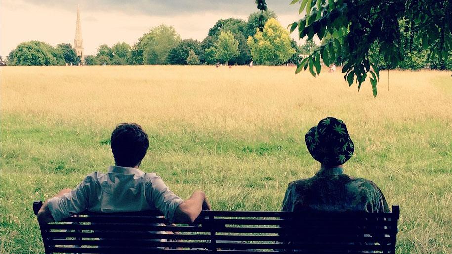two men sitting on bench