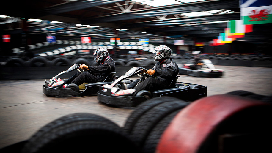 people in go karts