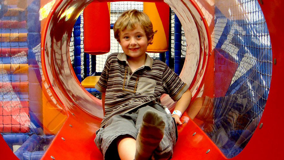 boy in soft play tunnel