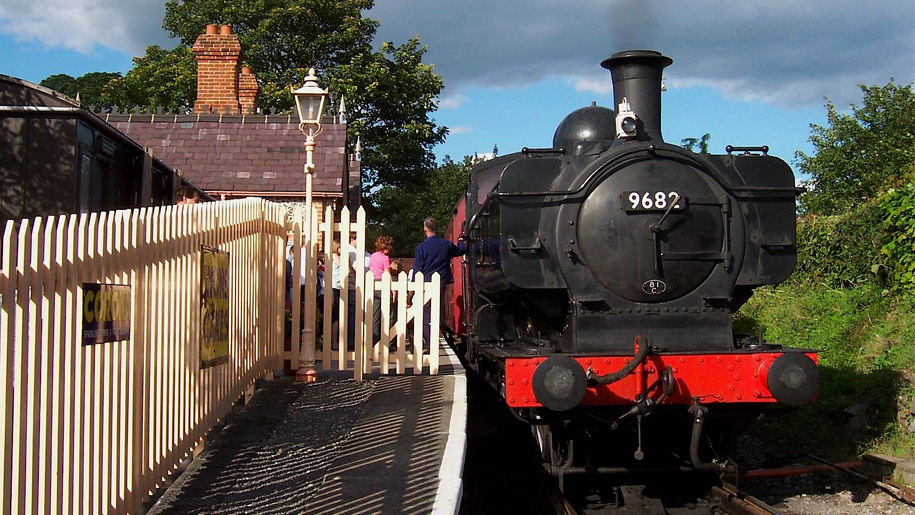 steam train by picket fence