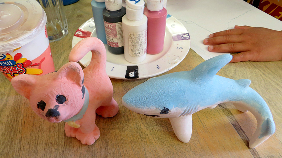 painted cat and dolphin ceramic