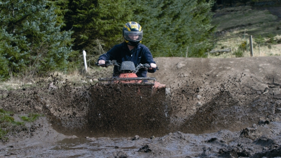 quad biking through mud