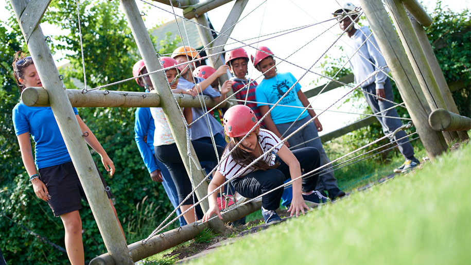 children going through obstacle course