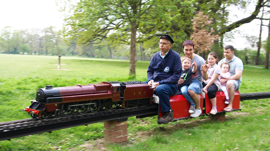 family on miniature steam train
