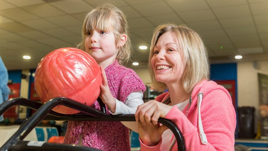 Child bowling at Guildford Spectrum
