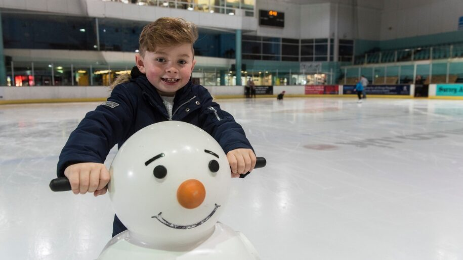 Child using snowman skate aid at Guildford Spectrum
