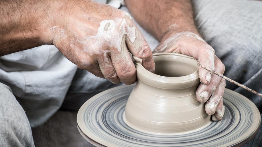 man making pot