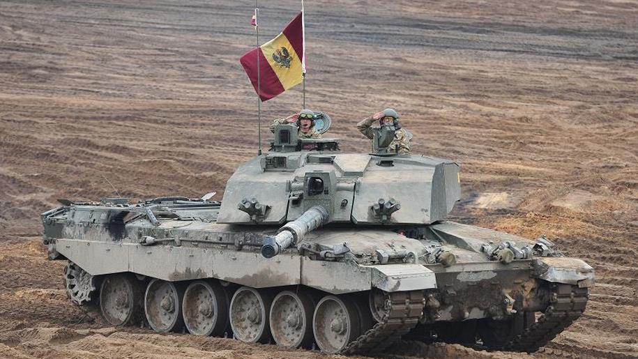 two men saluting in tank