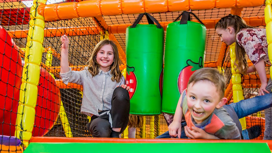 girl and boy in soft play area