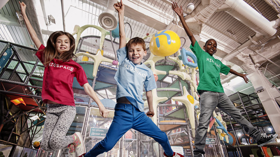 children jumping outside soft play area