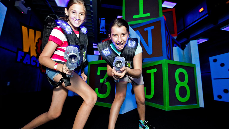 Girls playing laser tag