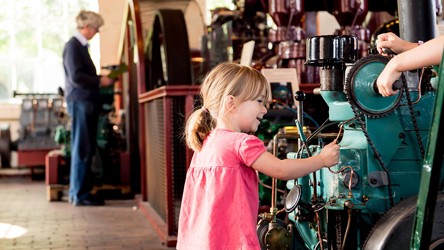 girl looking at machinery