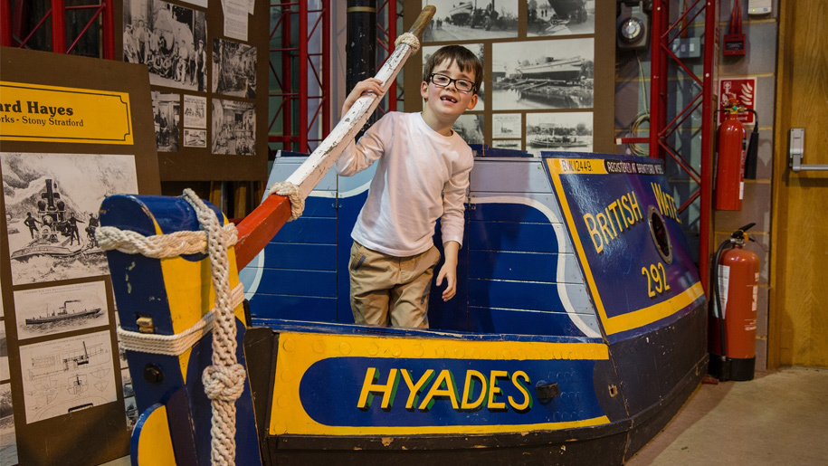 boy on fake boat