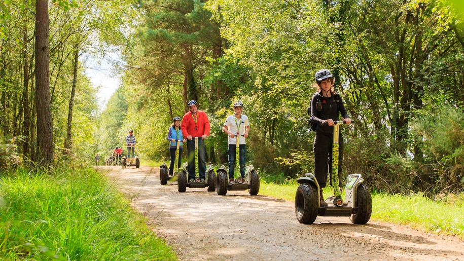 family on segways in the forest