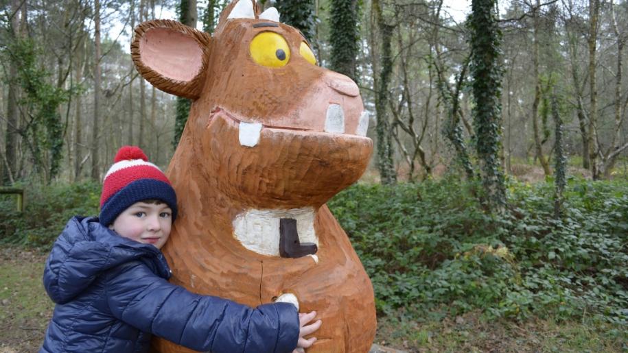 little boy hugging Gruffalo