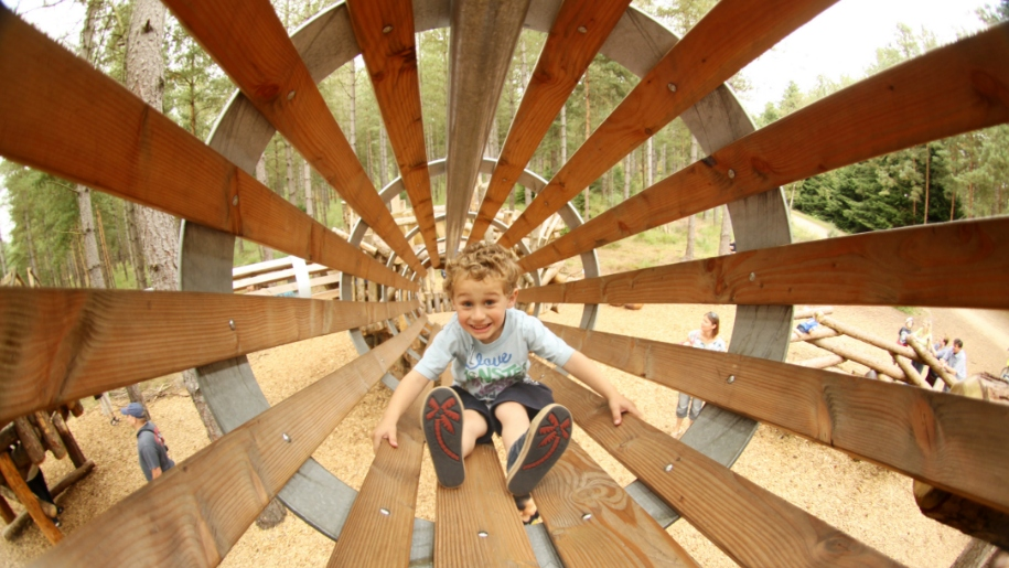 child in wooden tunnel