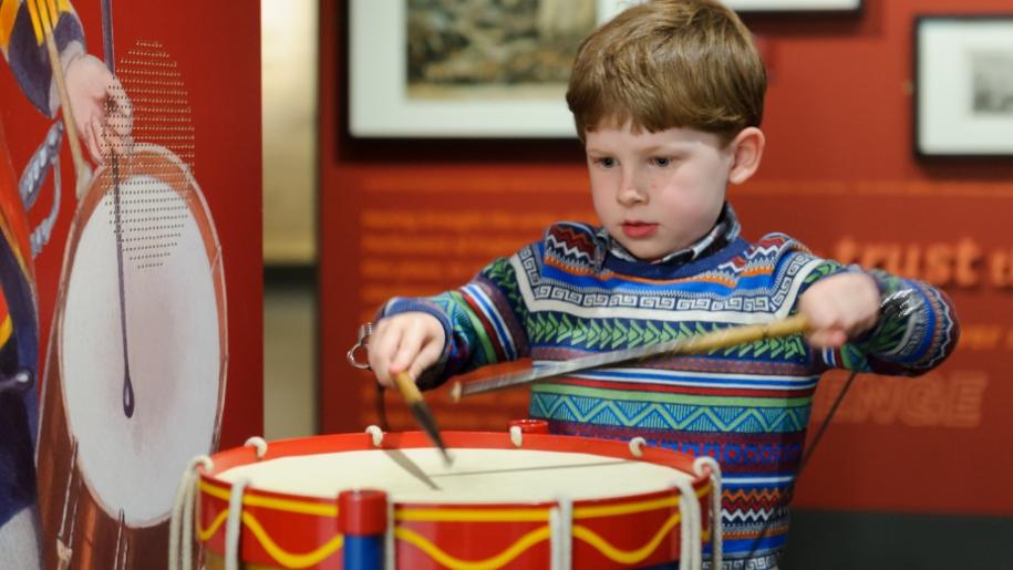 little boy drumming interactive