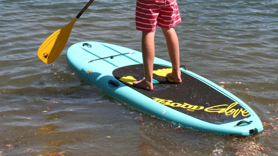 boy paddle boarding