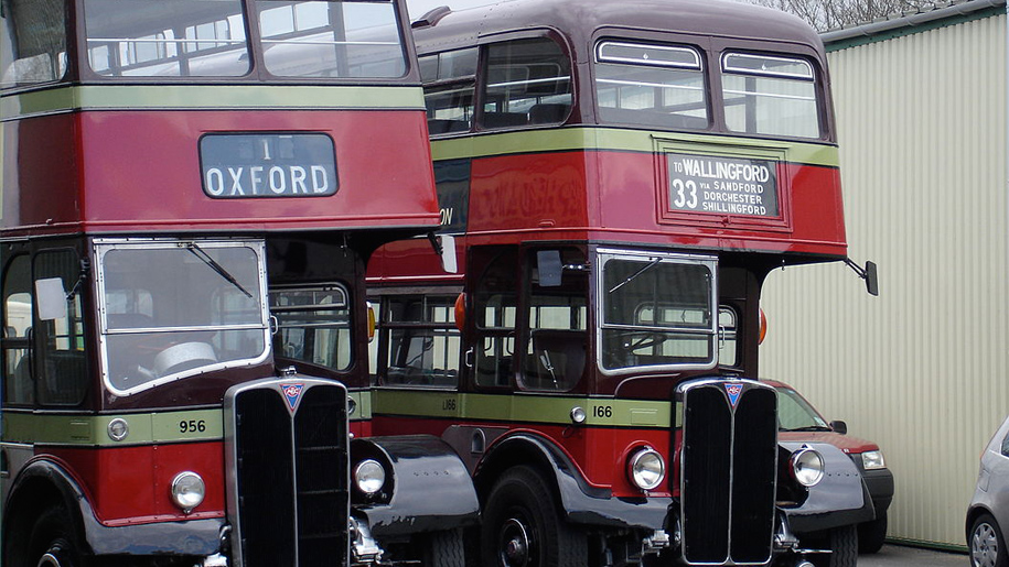 old fashioned double decker red buses