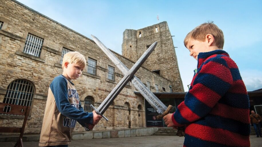 Children sword fighting at Oxford Castle