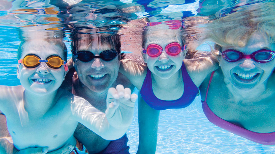 family swimming under water