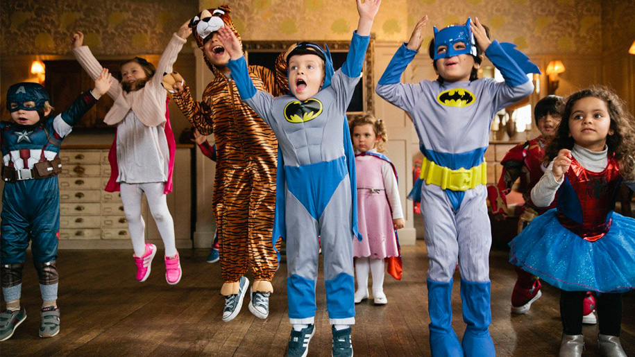children as super heroes jumping