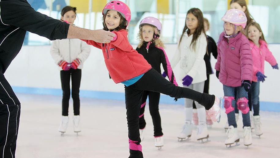 children learning to iceskate