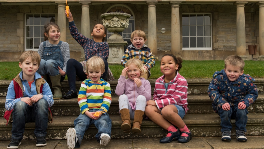 children sitting on steps outside Ragley Hall