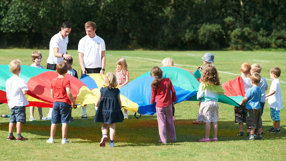 children playing with parachute