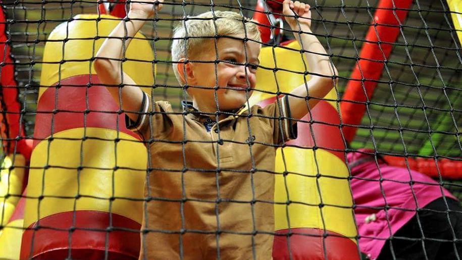 boy behind netting