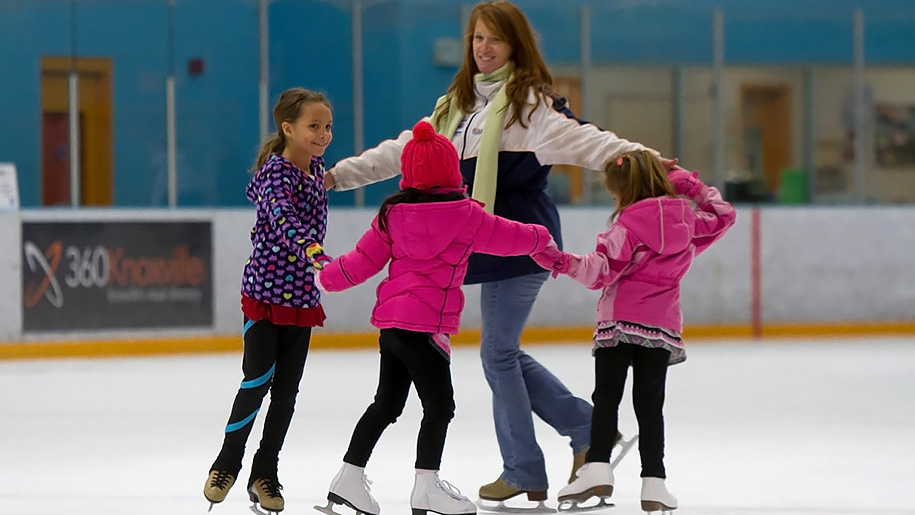 girls learning to ice-skate
