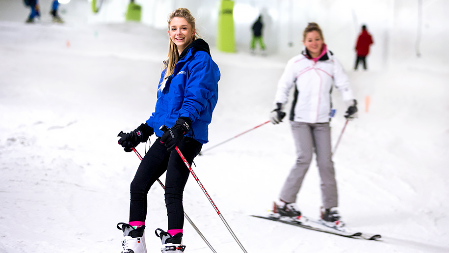 girls on skis with poles