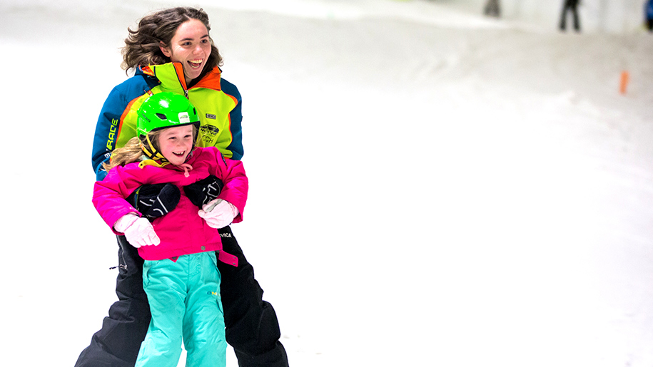mother and daughter learning to ski