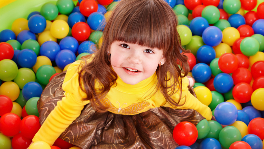 Girl in ball pit