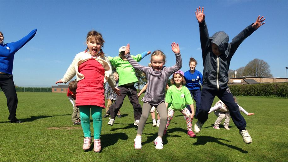 children doing star jumps