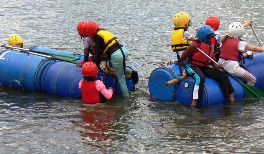 children climbing on barrel