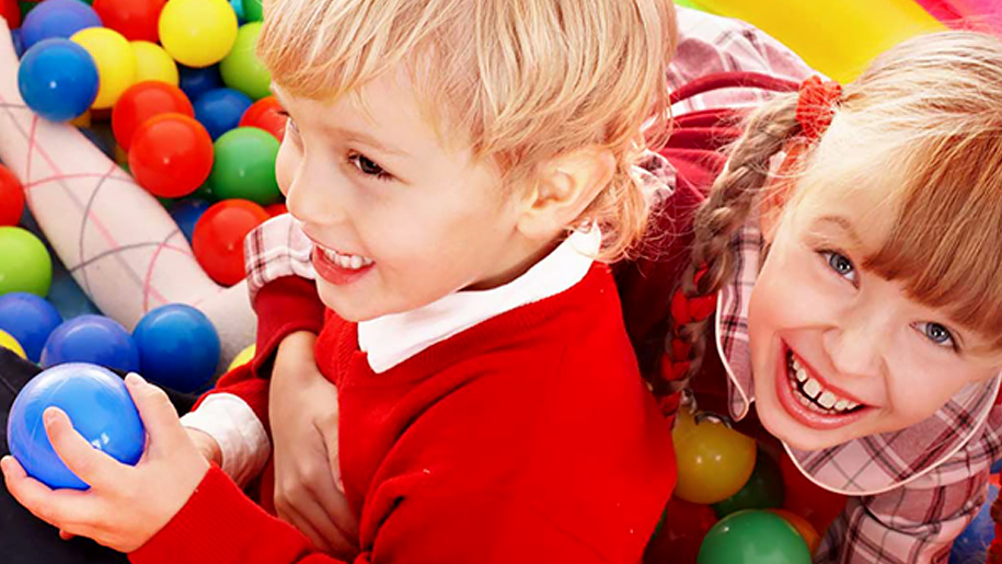 boy and girl in ball pool