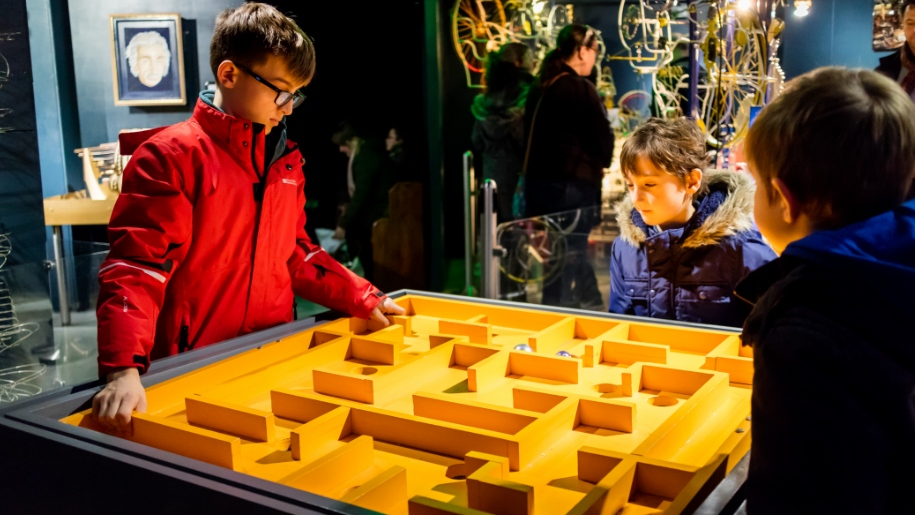 kids using maze at museum