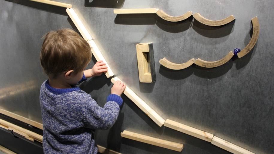 child playing with wall art