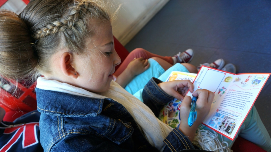 child with booklet