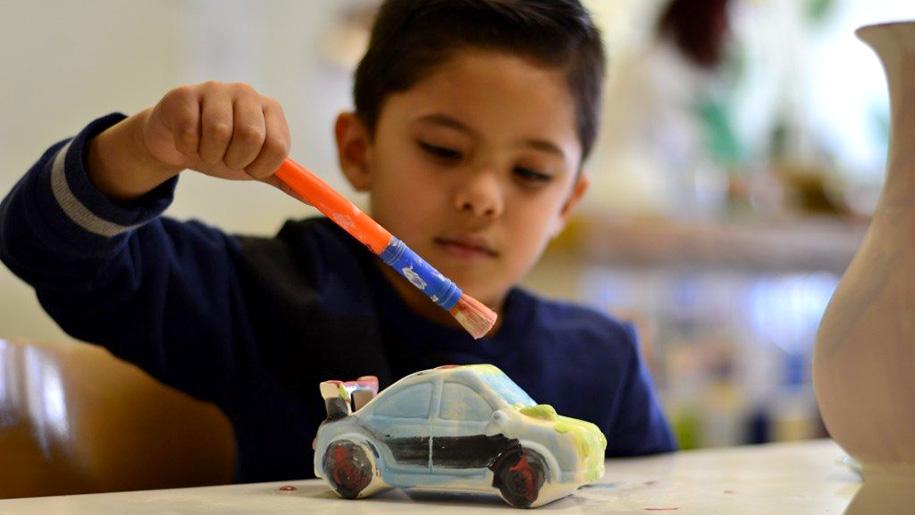 boy painting car
