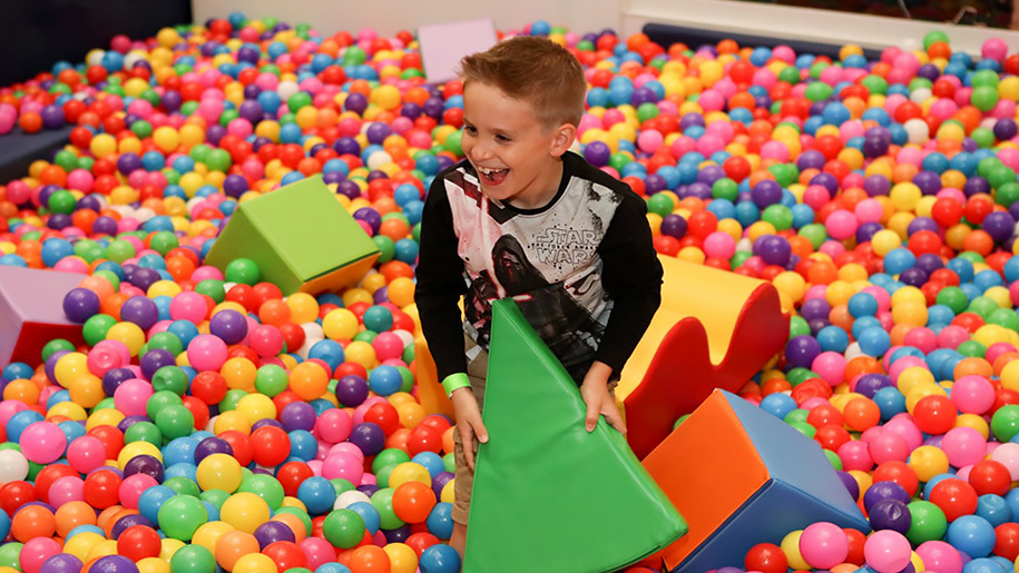 boy in soft play area