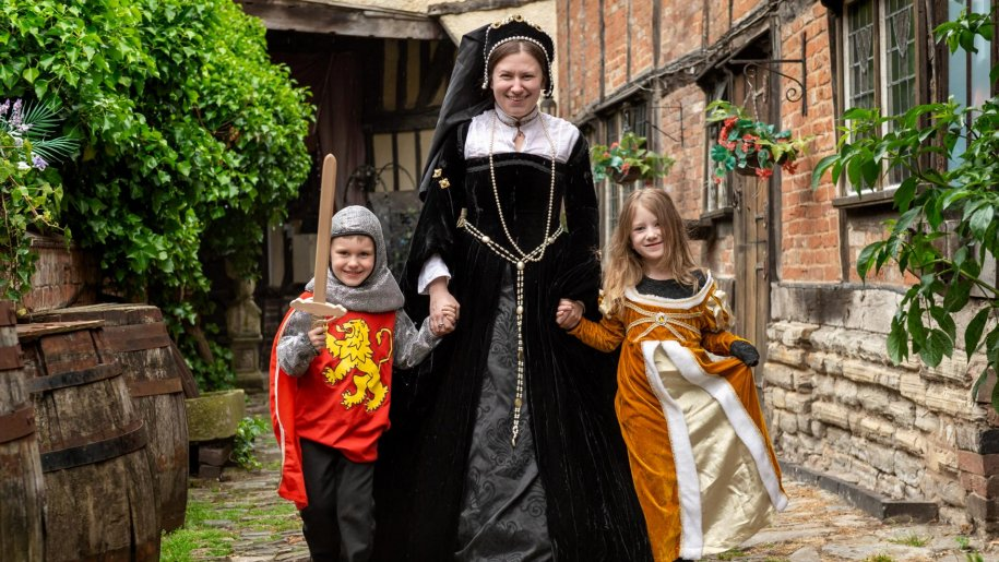 Woman and two children in historical costume at Tudor World
